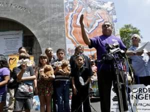 An activist speaks during a rally for immigrant rights in San Diego.