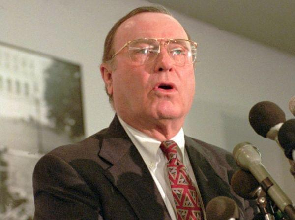 In a June 30, 1995 file photo, Alan Dixon meets reporters on Capitol Hill.