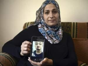Suha Abu Khdeir holds picture of her son, Tariq Abu Khdeir, a U.S. citizen.