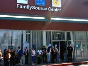 "People line up at the FamilySource Center in Los Angeles, an organization in one of President Obama's five designated ""Promise Zones"" that aims to help fight poverty in the area."