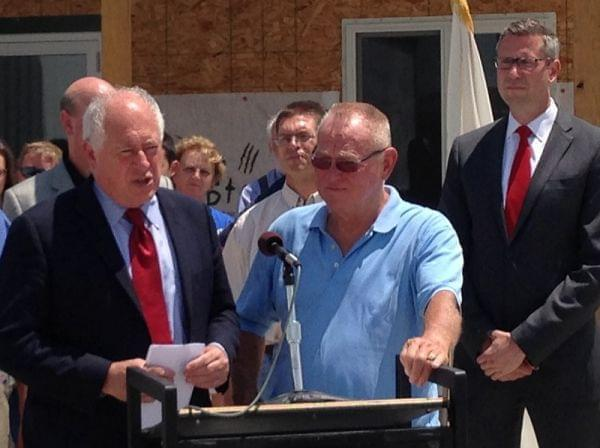 (l to r) Gov. Pat Quinn speaks during a press conference in Gifford, Ill. on July 7, 2014. Gifford village president Derald Ackerman and State Sen. Mike Freirchs (D-Champaign) stand beside him.