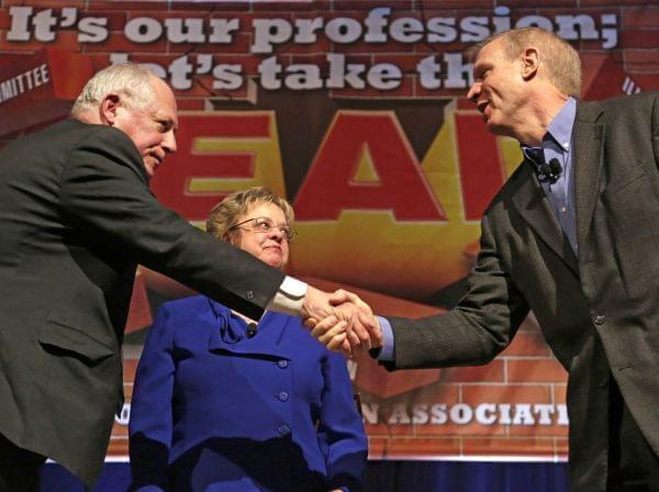 Illinois Gov. Pat Quinn, left, and his Republican rival, Bruce Rauner, shake hands after they appeared together for the first time before the 2014 general election, during the annual meeting of the Illinois Education Association Friday, April 11, 201