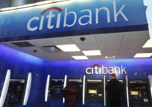 In this Jan. 6, 2012 photo, a Citibank customer makes a transaction at an ATM, in New York.