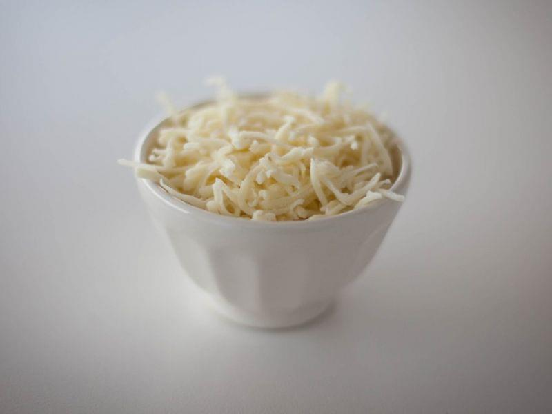 You can find wood pulp in several brands of packaged shredded cheese. It helps keep the cheese from clumping.