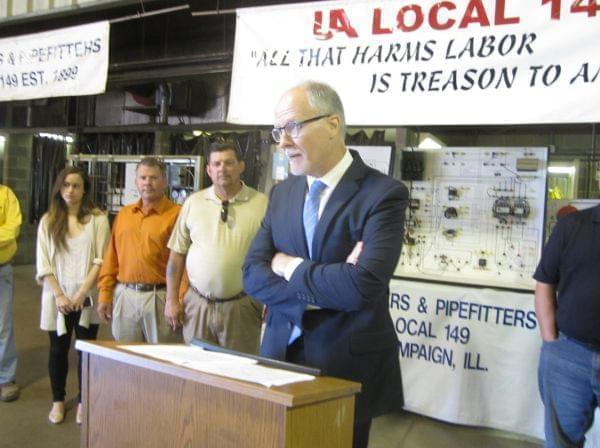 Democratic Lt. Gov. candidate Paul Vallas calls on GOP gov. candidate Bruce Rauner to release his full tax returns during a news conference in Savoy, IL.