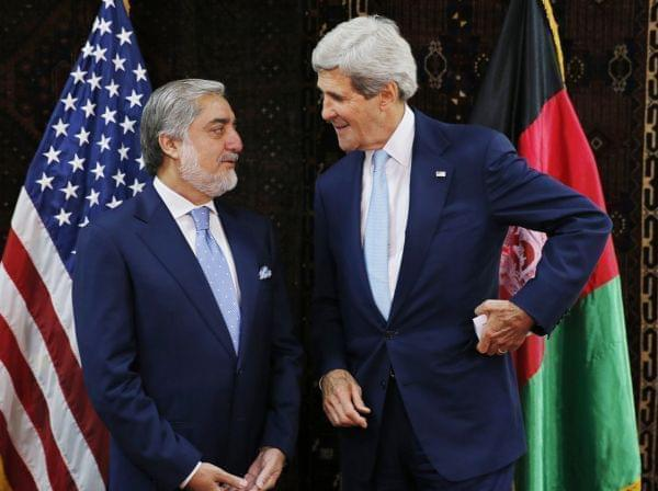 U.S. Secretary of State John Kerry talks with Afghan presidential candidate Abdullah Abdullah at the start of a meeting at the U.S. Embassy in Kabul on Friday. Kerry sought Friday to broker a deal between Afghanistan's rival presidential candida