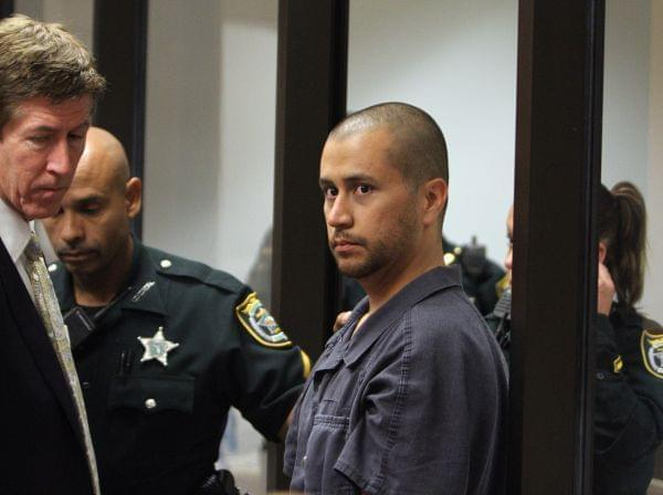 George Zimmerman, center, is directed by a Seminole County Deputy and his attorney Mark O'Mara during a court hearing Thursday April 12, 2012, in Sanford, Fla.