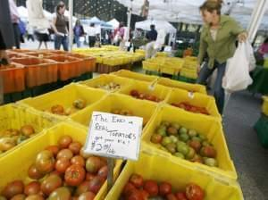 Shoppers pick through season-end tomatoes at the Chicago Farmers market in Federal Plaza Tuesday, Sept. 26, 2006, in Chicago. The market is open on Tuesdays through the end of October.