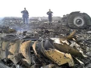 Ukrainian workers are seen at site of crash site