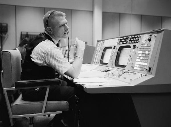 NASA flight director Eugene F. Kranz at his console in Mission Control in Houston on May 30, 1965, during a Gemini-Titan IV simulation to prepare for the four-day, 62-orbit flight.