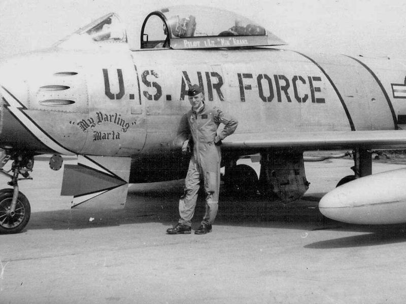 Kranz poses in front of the F-86 Sabre he flew as part of the U.S. Air Force 69th Fighter Bomber Squadron in Korea. He named his plane