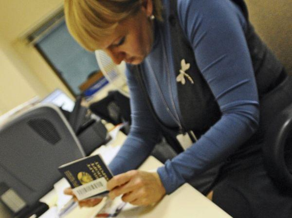An employee looks at a Russian foreign passport at the U.S. Embassy in Moscow.