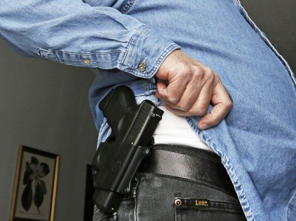 Hank Johnson displays his Glock handgun, inside his home in Springboro, Ohio. D.C. lawmakers had hoped to maintain a ban on carrying handguns in public, but a district court last week overturned it.