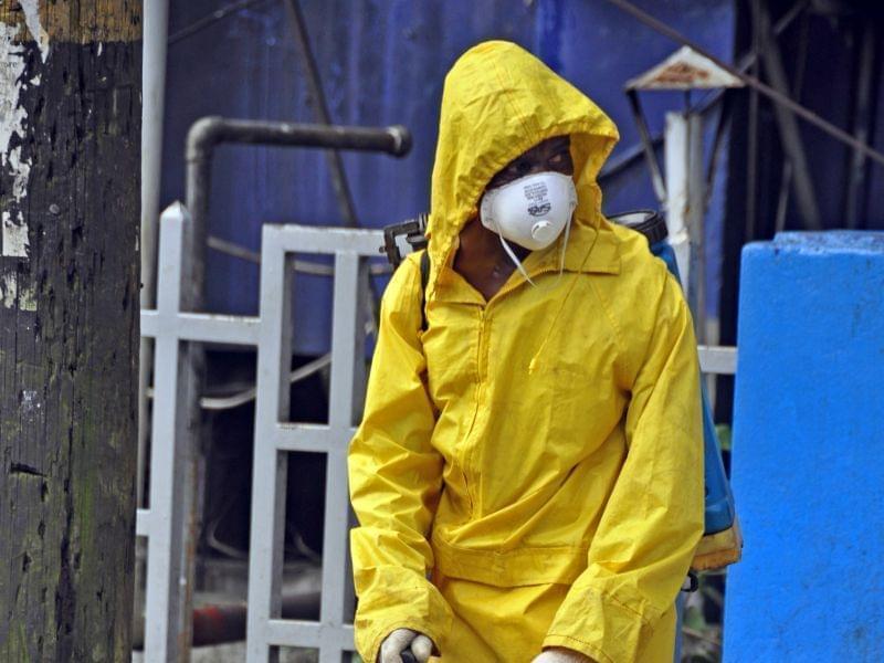 Monrovia City Corporation employee sprays disinfectant