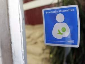"A decal reading ""Breastfeeding Welcomed Here"" is displayed on the door to a store on Thursday, Aug. 11, 2011, in Nashville, Tenn. Nashville's Metro Health Department is encouraging local businesses to make breastfeeding mothers fee"