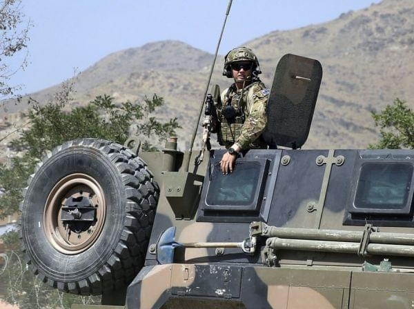 NATO soldier keeps watch near Kabul Tuesday.