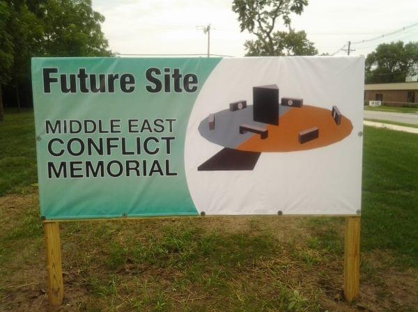 A sign posted on a vacant lot in Danville announces the future site of the Middle East Conflicts Veterans Memorial, including an artist's depiction of the design.