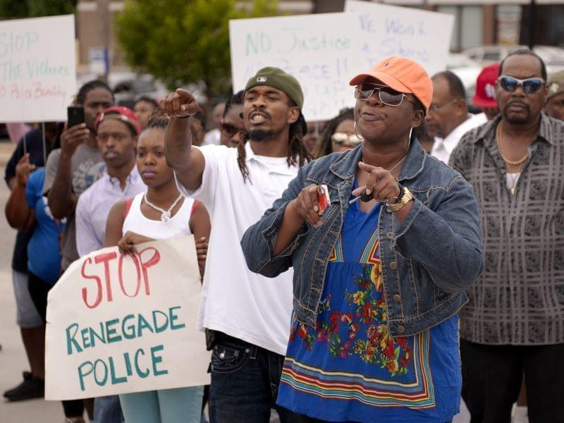 Protesters confront police Sunday in Ferguson, MO.