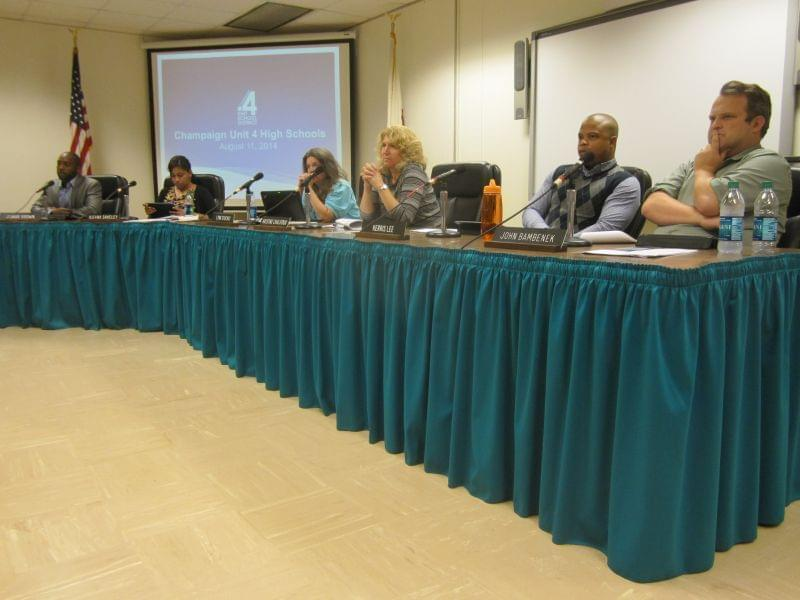 Members of the Champaign Unit Four School Board, seated during the Monday, August 11th meeting, in which a high school bond referendum was approved to go on the November ballot.