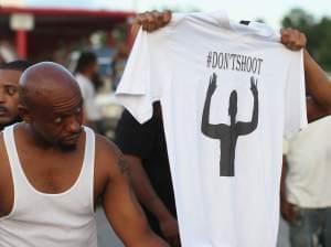 Demonstrators protest killing of Michael Brown, 18, in Ferguson, MO.