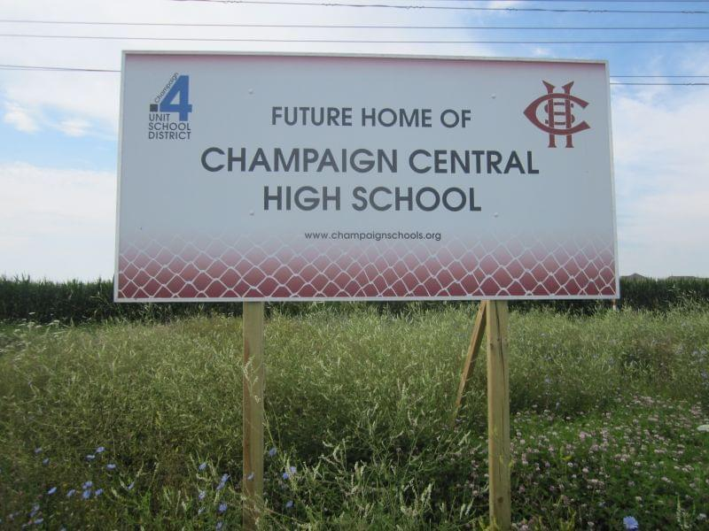 A sign in a field on Olympian Drive announces the site as the future home of Champaign Central High School