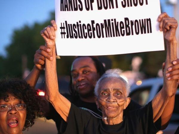 Creola McCalister protests the killing of teenager Michal Brown Tuesday.