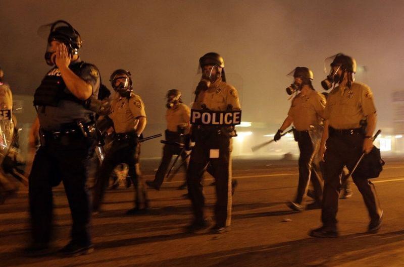 Police fire tear gas in Ferguson