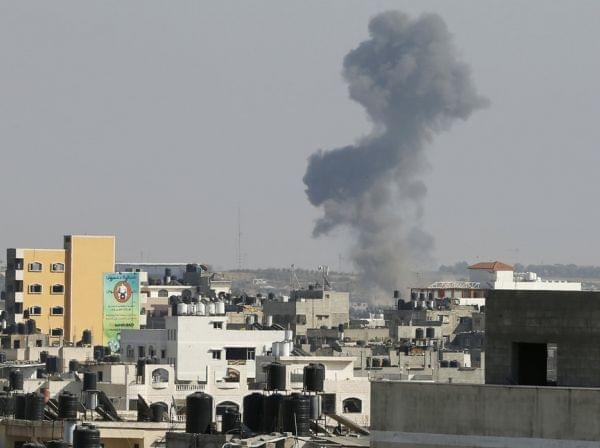 Smoke is seen after what witnesses call an Israeli airstrike in Gaza City.
