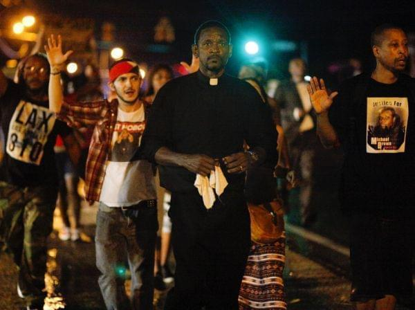 Clergyman leads demonstrators in Ferguson, Mo.