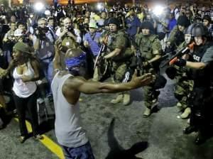 Police arrest a man on Aug. 9th in Ferguson, Mo.
