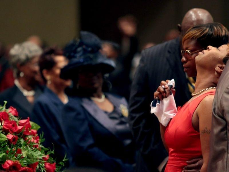 Lesley McSpadden is comforted during funeral for her son, Michael Brown.