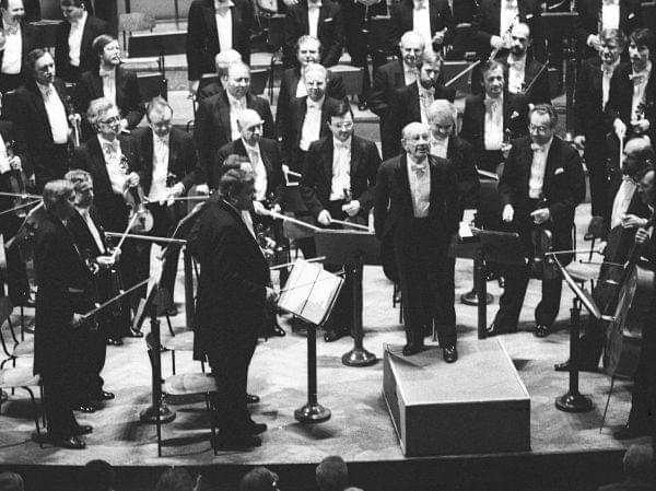 A man conducting an orchestra.