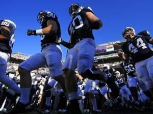 Members of the 2013 Penn State football team take the field.