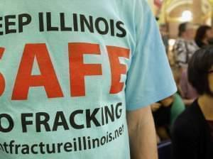 A protester attends a rally on fracking in Springfield in May 2013.