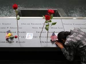 A woman grieves at her husband's memorial at the South Tower Memorial Pool on the 13th anniversary of September 11.