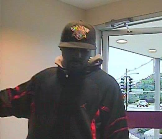 Photo captured by security camera of suspect in the robbery at First Midwest Bank at Prospect and Springfield in Champaign.
