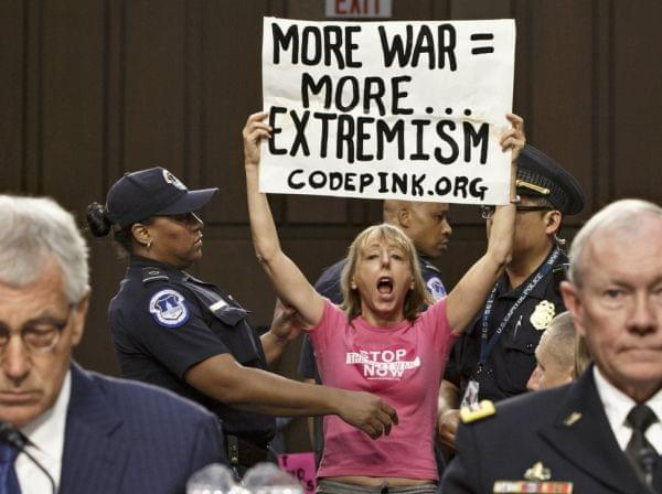 Members of protest group CodePink interrupt a Senate Armed Services Committee hearing
