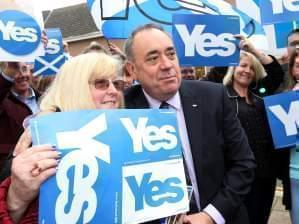 Scotland First Minister Alex Salmond poses for photos with Yes campaigners in Turriff, Scotland.