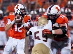 Illinois quarterback Wes Lunt (12) prepares to throw the ball during the fourth quarter versus Texas State Saturday.