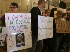 Supporters of Steven Salaita hold signs and chant outside the Academic Senate meeting on Monday.