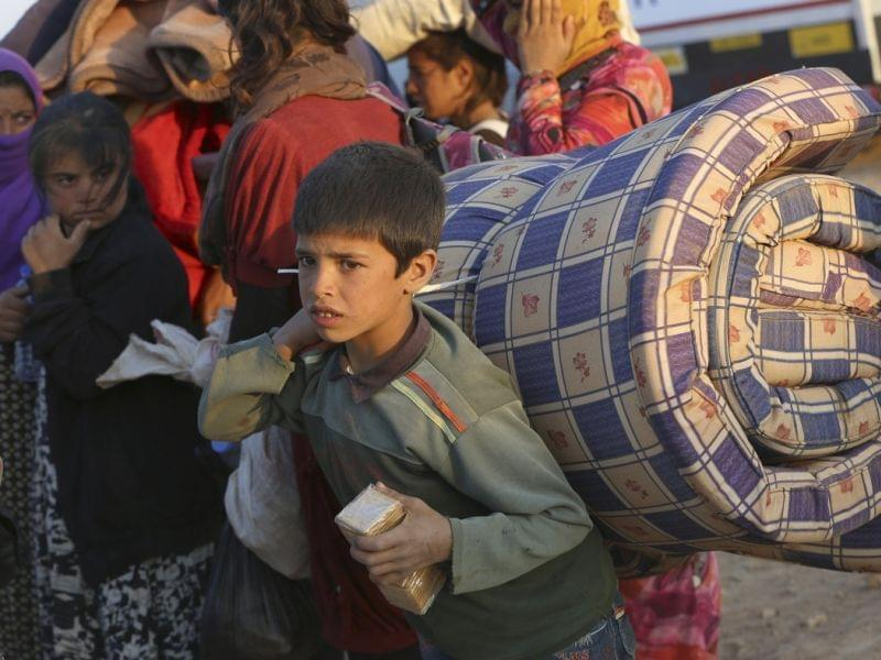 Thousands of Syrians enter Turkey Tuesday.