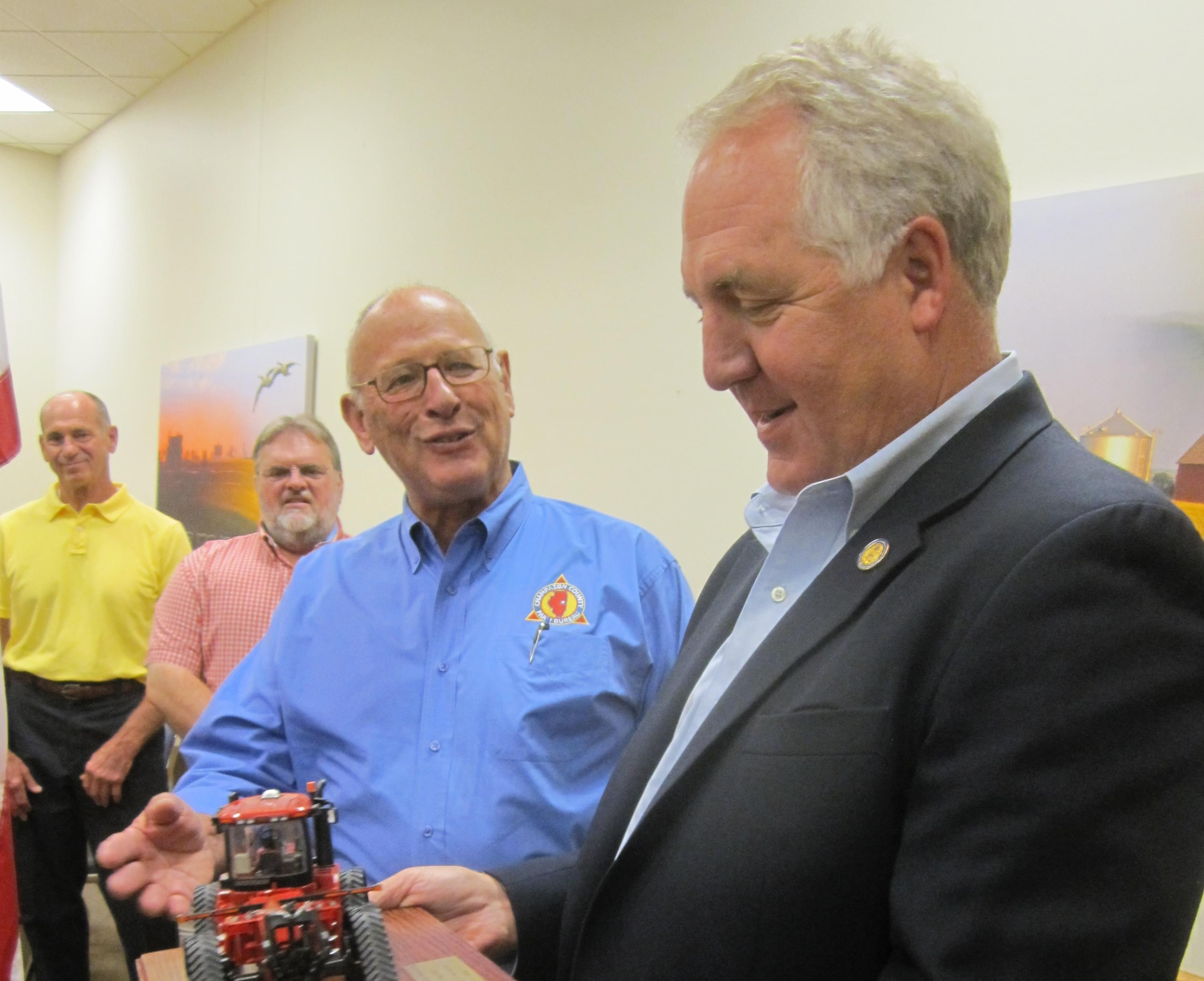 Congressman John Shimkus holds his ACTIVATOR Friend of Agriculture Award.