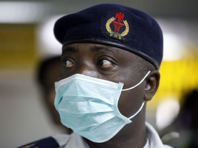 A Nigerian health official at Murtala Muhammed International Airport in Lagos, Nigeria on August 4th.
