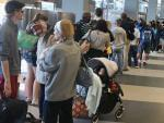 Travelers lined up Friday at O'Hare International Airport.