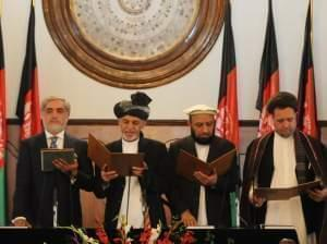 Ashraf Ghani Ahmadzai stands next to Afghanistan's Chief Executive Abdullah Abdullah and two deputy officials as he takes the oath during the inauguration ceremony in Kabul.