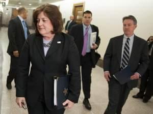 Secret Service Director Julia Pierson enters a hearing room in April.