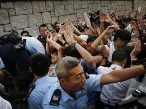 Student protesters in Hong Kong resist during a change of shift for local police.