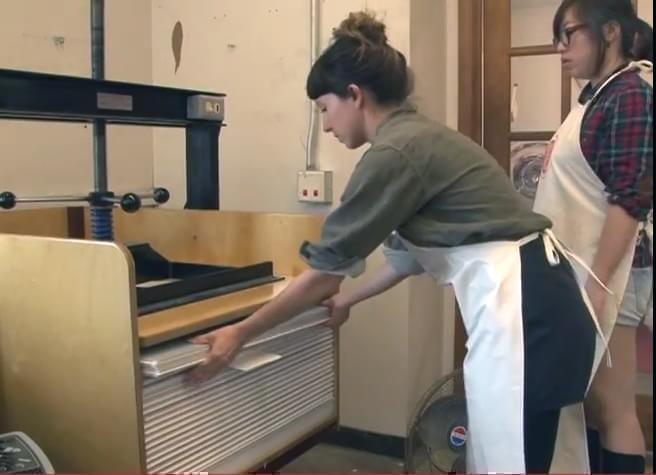 two people making paper