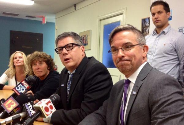 Same-sex couples involved in the lawsuit in Indiana appear at a news conference.