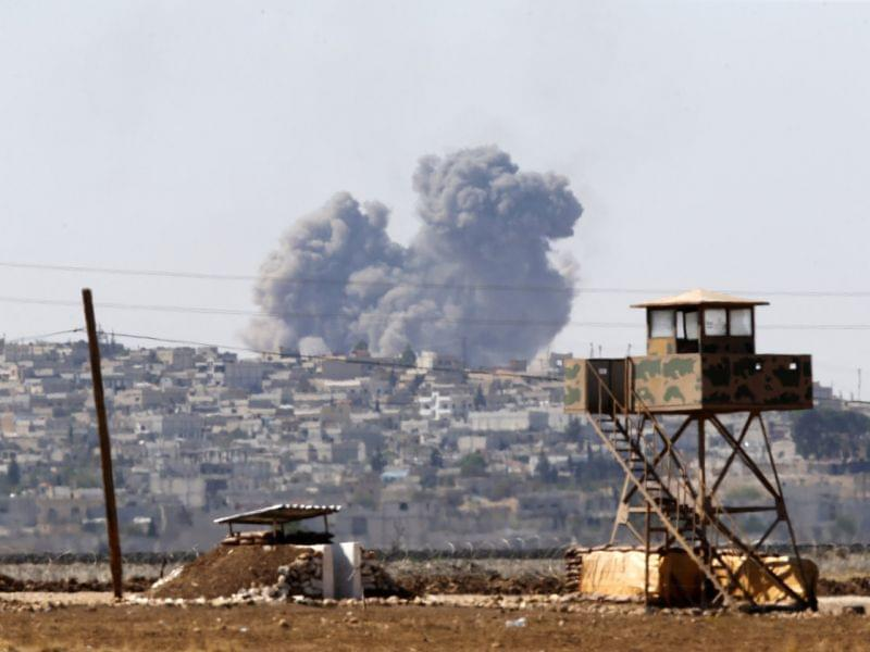 Smoke rises from the Syrian town of Kobani, near the Syrian border.
